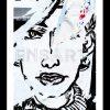 photo-urbaine-dessin-visage-affiche-dechiree-paris
